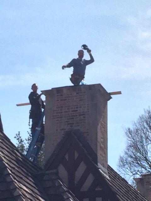 men working on roof